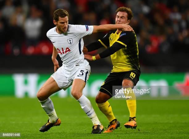 Jan Vertonghen of Tottenham Hotspur and Mario Gotze of Borussia Dortmund battle for possession during the UEFA Champions League group H match between...