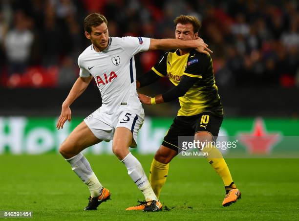 Jan Vertonghen of Tottenham Hotspur and Mario Gotze of Borussia Dortmund battle for possession during the UEFA Champions League group H match between...