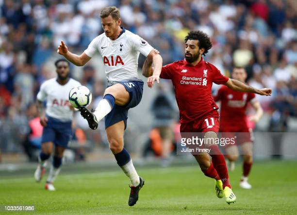 Jan Vertonghen of Tottenham Hotspur and Mohamed Salah of Liverpool battle for the ball during the Premier League match between Tottenham Hotspur and...
