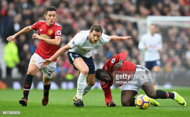 Jan Vertonghen of Tottenham Hotspur and Romelu Lukaku of Manchester United battle for possession during the Premier League match between Manchester...