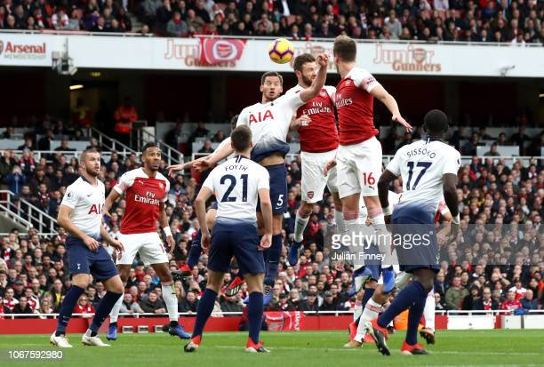 Jan Vertonghen of Tottenham Hotspur and Shkodran Mustafi of Arsenal battle for possession leading to a penalty decision during the Premier League...