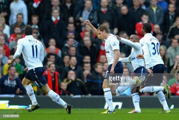 Jan Vertonghen of Tottenham Hotspur celebrates scoring the opening goal with team mates Gareth Bale Jermain Defoe and Sandro during the Barclays...