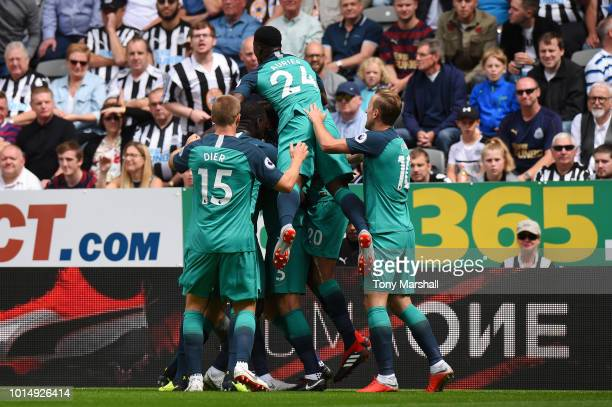 Jan Vertonghen of Tottenham Hotspur celebrates with teammates after scoring his team's second goal during the Premier League match between Newcastle...