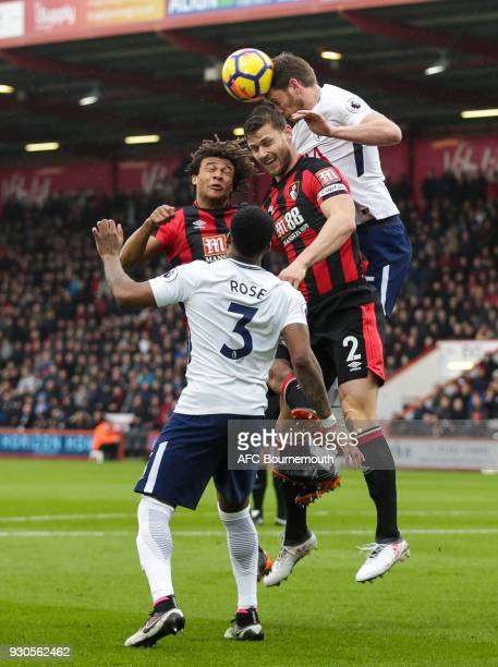 Jan Vertonghen of Tottenham Hotspur clears from Nathan Ake of Bournemouth and Simon Francis of Bournemouth during the Premier League match between...