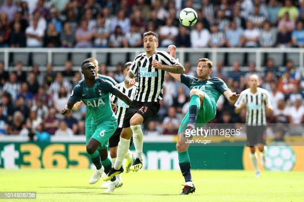 Jan Vertonghen of Tottenham Hotspur controls the ball ahead of Joselu of Newcastle United during the Premier League match between Newcastle United...