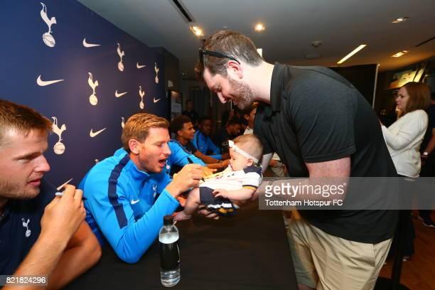 Jan Vertonghen of Tottenham Hotspur FC via Getty Images signs autographs for fans during a visit to Nike Town on Tottenham Hotspur Pre-Season Tour to...