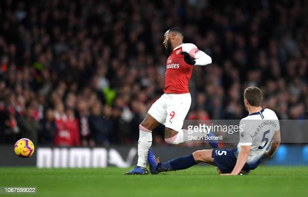 Jan Vertonghen of Tottenham Hotspur fouls Alexandre Lacazette of Arsenal leading to a second yellow card for Jan Vertonghen during the Premier League...