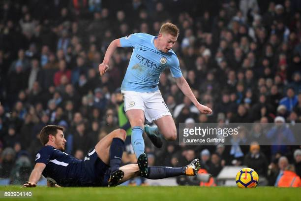 Jan Vertonghen of Tottenham Hotspur fouls Kevin De Bruyne of Manchester City and a penalty is awarded during the Premier League match between...