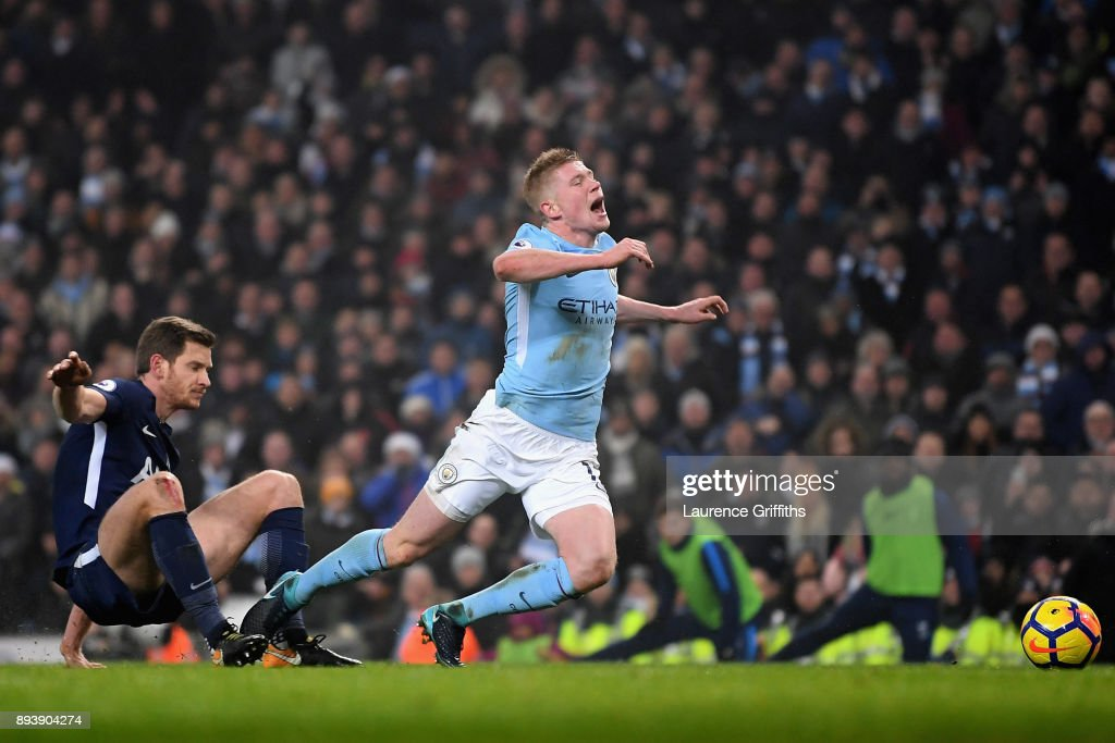 Jan Vertonghen of Tottenham Hotspur fouls Kevin De Bruyne of Manchester City and a penalty is awarded during the Premier League match between Manchester City and Tottenham Hotspur at Etihad Stadium on December 16, 2017 in Manchester, England.