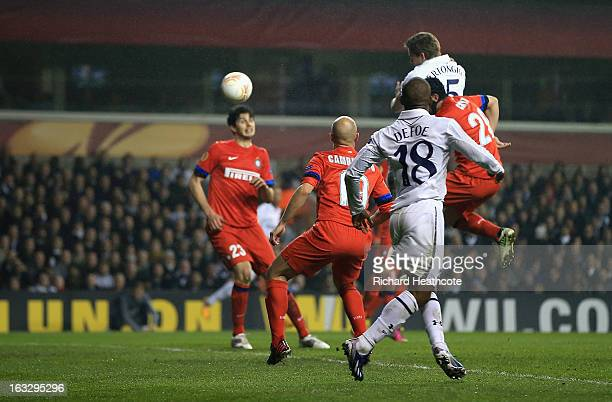 Jan Vertonghen of Tottenham Hotspur heads the ball and scores his side's third goal during the UEFA Europa League Round of 16 First Leg match between...
