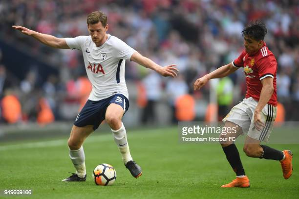 Jan Vertonghen of Tottenham Hotspur is challenged by Alexis Sanchez of Manchester United during The Emirates FA Cup Semi Final between Manchester...