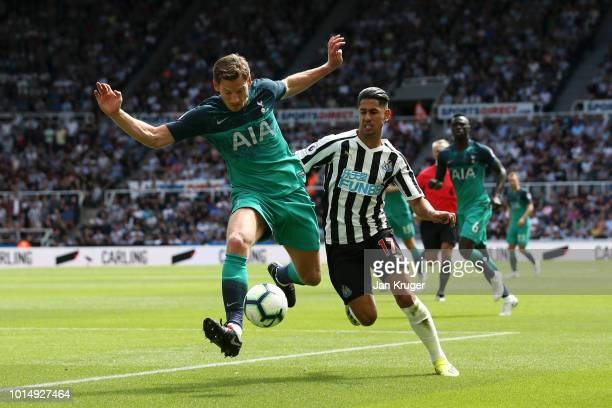 Jan Vertonghen of Tottenham Hotspur is challenged by Ayoze Perez of Newcastle United during the Premier League match between Newcastle United and...
