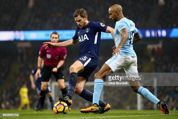 Jan Vertonghen of Tottenham Hotspur is challenged by Fabian Delph of Manchester City during the Premier League match between Manchester City and...