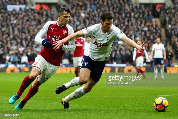 Jan Vertonghen of Tottenham Hotspur is challenged by Granit Xhaka of Arsenal during the Premier League match between Tottenham Hotspur and Arsenal at...