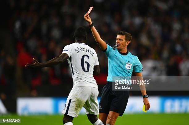 Jan Vertonghen of Tottenham Hotspur is shown a red card by referee Gianluca Rocchi as Davinson Sanchez of Tottenham Hotspur appeals during the UEFA...