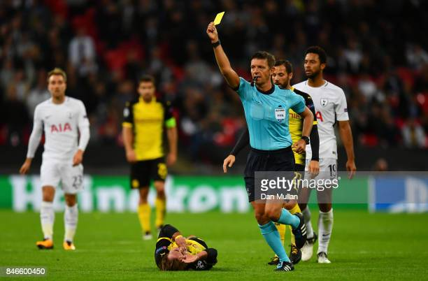 Jan Vertonghen of Tottenham Hotspur is shown a red card by referee Gianluca Rocchi during the UEFA Champions League group H match between Tottenham...