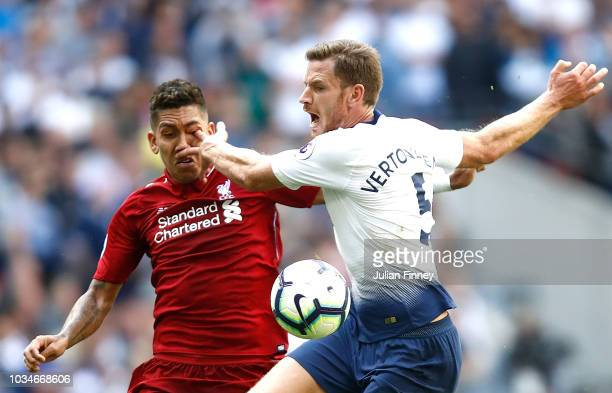 Jan Vertonghen of Tottenham Hotspur pokes Roberto Firmino of Liverpool in the eye as they battle for the ball during the Premier League match between...