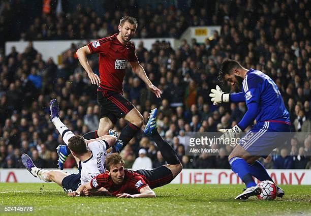Jan Vertonghen of Tottenham Hotspur pressures Craig Dawson of West Bromwich Albion into scoring an own goal for their first past goalkeeper Boaz...