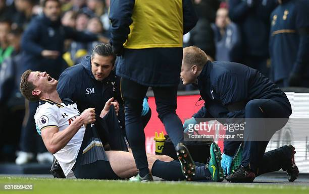 Jan Vertonghen of Tottenham Hotspur receives treatment from the medical team during the Premier League match between Tottenham Hotspur and West...