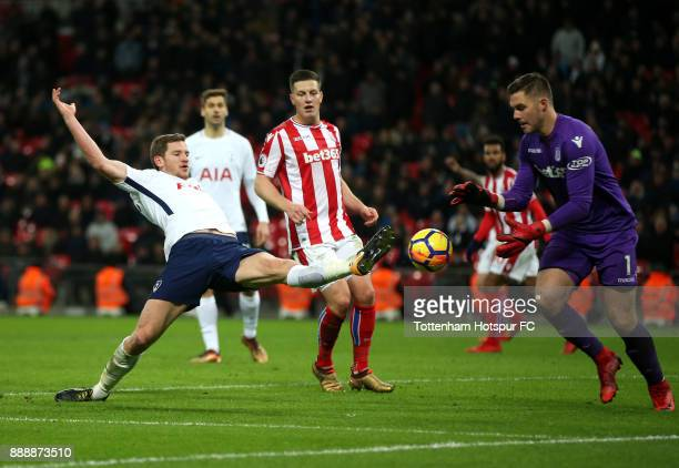 Jan Vertonghen of Tottenham Hotspur stretches for the ball as Jack Butland of Stoke City collects during the Premier League match between Tottenham...
