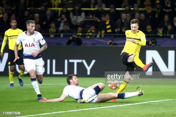 Jan Vertonghen of Tottenham Hotspur tackles Marco Reus of Borussia Dortmund during the UEFA Champions League Round of 16 Second Leg match between...