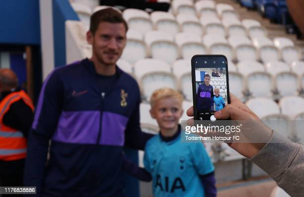 Jan Vertonghen of Tottenham Hotspur takes a photo with a fan prior to the Carabao Cup Third Round match between Tottenham Hotspur and Colchester...