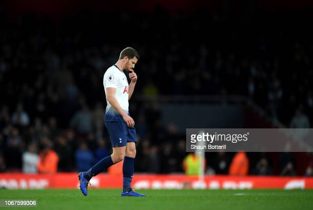 Jan Vertonghen of Tottenham Hotspur walks off the pitch after being shown a second yellow card during the Premier League match between Arsenal FC and...
