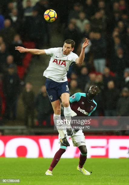 Jan Vertonghen of Tottenham Hotspur wins a header from Cheikhou Kouyate of West Ham United during the Premier League match between Tottenham Hotspur...