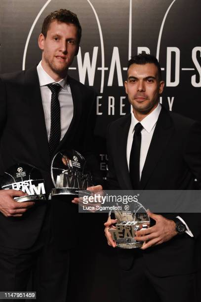 Jan Vesely #24 of Fenerbahce BEKO Istanbul and Kostas Sloukas #16 of Fenerbahce BEKO Istanbul pose with 20182019 MVP and First Team Trophys at the...