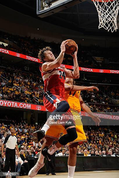 Jan Vesely of the Washington Wizards goes up for the basket against Anderson Varejao of the Cleveland Cavaliers at The Quicken Loans Arena on October...