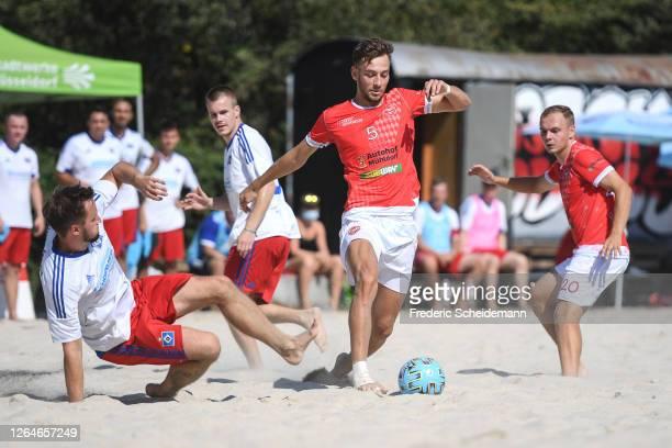 Jan Vetter of Beach Boys Waldkraiburg against Matthias Gote of Hamburger SV during the German Beachsoccer League match between Hamburger SV and Beach...