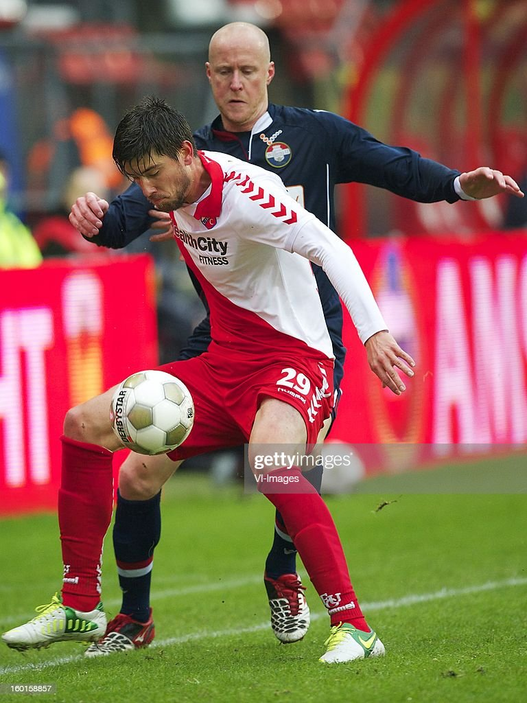 Jan Wuytens of FC Utrecht, Danny Guijt of Willem II during the Dutch Eredivise match between FC Utrecht and Willem II at the Galgenwaard Stadium on January 27, 2013 in Utrecht, The Netherlands.