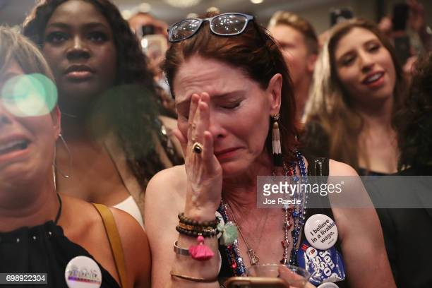 Jan Yanes reacts as vote results show Democratic candidate Jon Ossoff losing to his challengre during his election night party being held at the...