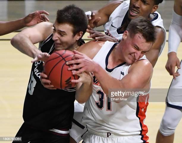 Jan Zidek of the Pepperdine Waves grabs a rebound against Josip Vrankic of the Santa Clara Broncos during the West Coast Conference basketball...