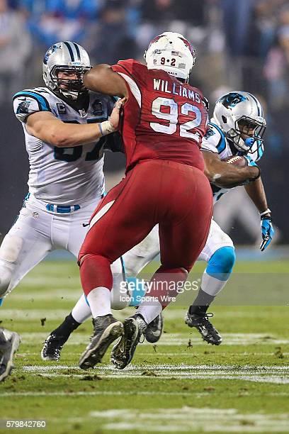 Carolina Panthers center Ryan Kalil blocks Arizona Cardinals nose tackle Dan Williams as running back Fozzy Whittaker runs behind them in the second...