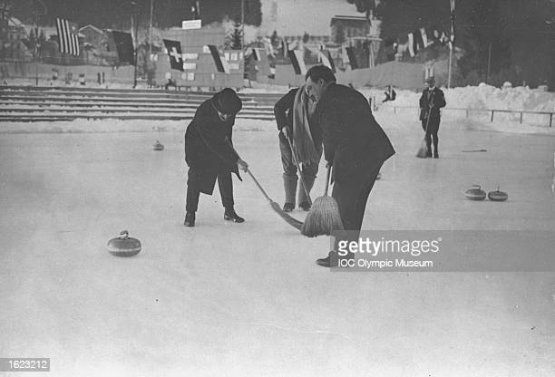 Gaston Vidal of France, Under-Secretary of State for technical education, in action during the Curling event at the 1924 Winter Olympic Games in...