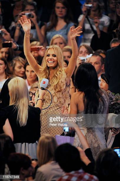 Jana Beller waves to her fans during the finalists show of 'Germany's Next Topmodel' at the LanxessArena on June 09 2011 in Cologne Germany