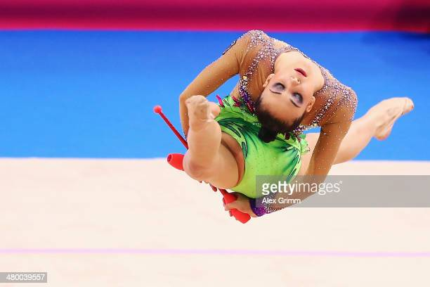 Jana Berezko-Marggrander of Germany performs with the clubs during the individual competition of the GAZPROM World Cup Rhythmic Gymnastics at Porsche...