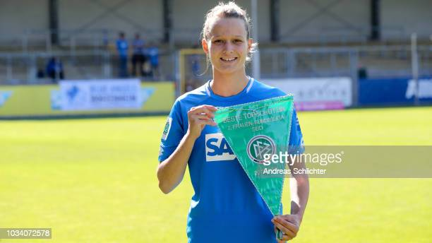 Jana Beuschel of TSG 1899 Hoffenheim presents her award for scoring the most goals during the last season prior to the AllianzFrauen Bundesliga match...