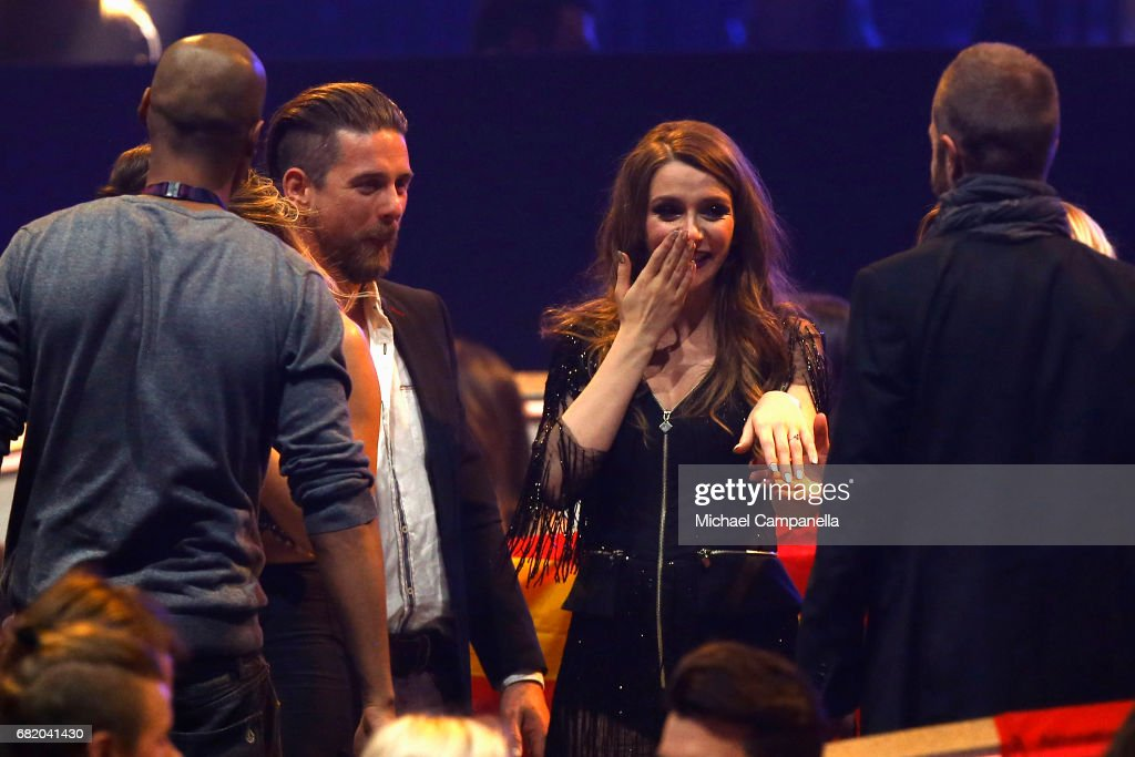 Jana Burceska representing Macedonia reacts after her boyfriend proposted to her during the second semi final of the 62nd Eurovision Song Contest at International Exhibition Centre (IEC) on May 11, 2017 in Kiev, Ukraine. The final of this years Eurovision Song Contest will be aired on May 13, 2017.