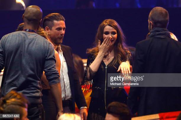Jana Burceska representing Macedonia reacts after her boyfriend proposted to her during the second semi final of the 62nd Eurovision Song Contest at...
