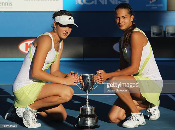 Jana Cepelova and Chantal Skamlova of Slovakia poses with the championship trophy after winning the junior doubles match against Timea Babos and...