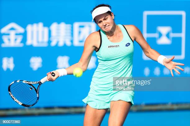 Jana Cepelova of Slovakia returns a shot during the match against Magada Linette of Poland during Day 1 of 2018 WTA Shenzhen Open at Longgang...