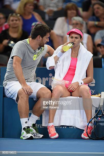 Jana Cepelova of Solvakia speaks with her coach during her match against Sam Stosur of Australia on day two of the 2016 Brisbane International at Pat...