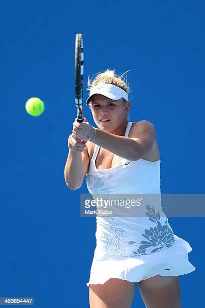 Jana Fett of Croatia plays a backhand in her first round junior girls' match against Nicole Kraemer of Australia during the 2014 Australian Open...
