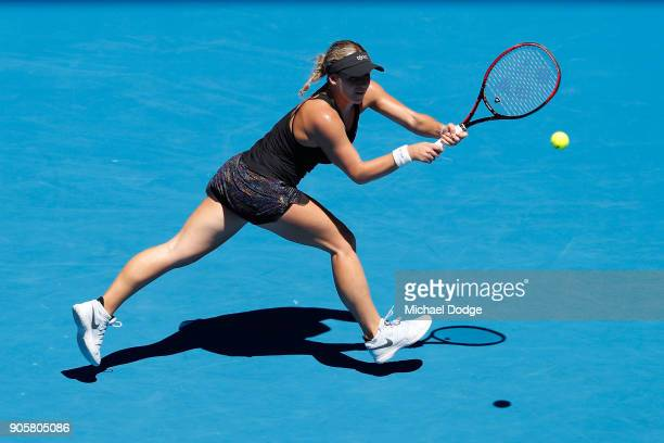 Jana Fett of Croatia plays a backhand in her second round match against Caroline Wozniacki of Denmark on day three of the 2018 Australian Open at...