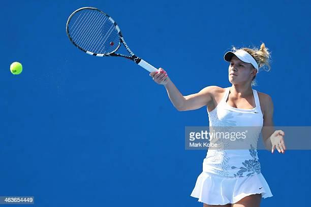 Jana Fett of Croatia plays a forehand in her first round junior girls' match against Nicole Kraemer of Australia during the 2014 Australian Open...