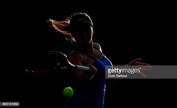 Jana Fett of Croatia plays a forehand in her first round match against Misa Eguchi of Japan of Croatia on day one of the 2018 Australian Open at...