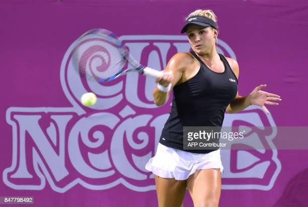 Jana Fett of Croatia returns a shot to Miyu Kato of Japan during their semifinal match of the Japan Women's Open tennis tournament in Tokyo on...