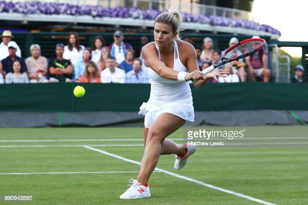 Jana Fett of Croatia returns against Daria Kasatkina of Russia during their Ladies' Singles first round match on day two of the Wimbledon Lawn Tennis...